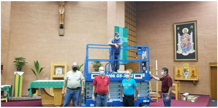 Replacing the light bulbs in the church